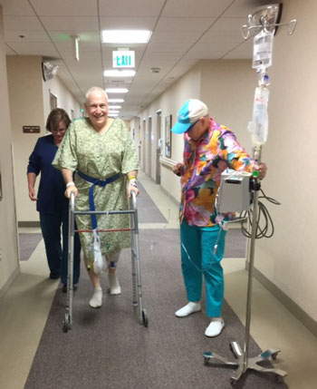 Taking a walk with my nurse and my wife, three hours after surgery