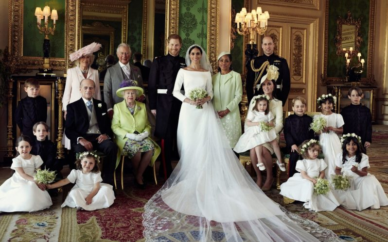 The Duke and Duchess of Sussex pose with their families and wedding party members in the Green Drawing Room at Windsor Castle on May 19. (Alexi Lubomirski/Duke and Duchess of Sussex/Getty Images)