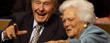Former President George H.W. Bush and first lady Barbara Bush point from their seats on day two of the Republican National Convention on September 2, 2008 in St. Paul, Minnesota. (Photo by Justin Sullivan - Getty Images)