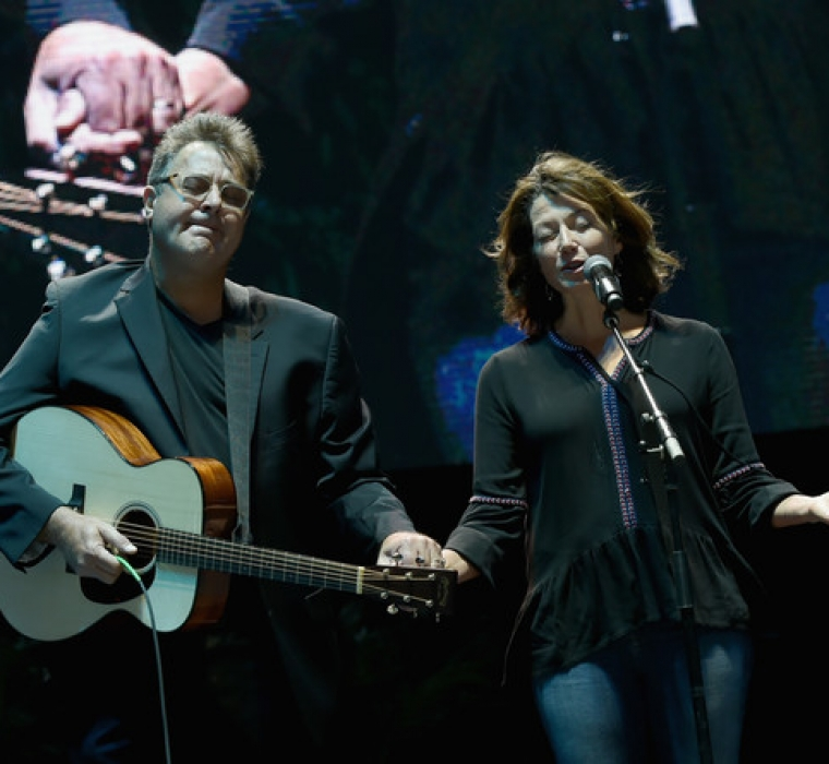 Singer:Songwriter Vince Gill joins Singer:Songwriter Amy Grant in prayer during Nashville Candelight Vigil For Las Vegas at Ascend Amphitheater on October 2, 2017 in Nashville, Tennessee.
