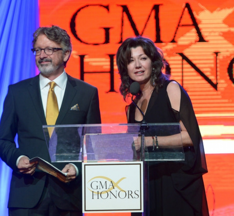 Songwriter Brown Bannister being inducted into the GMA Hall of Fame presented by singer-songwriter Amy Grant during the GMA Honors Celebration 2014