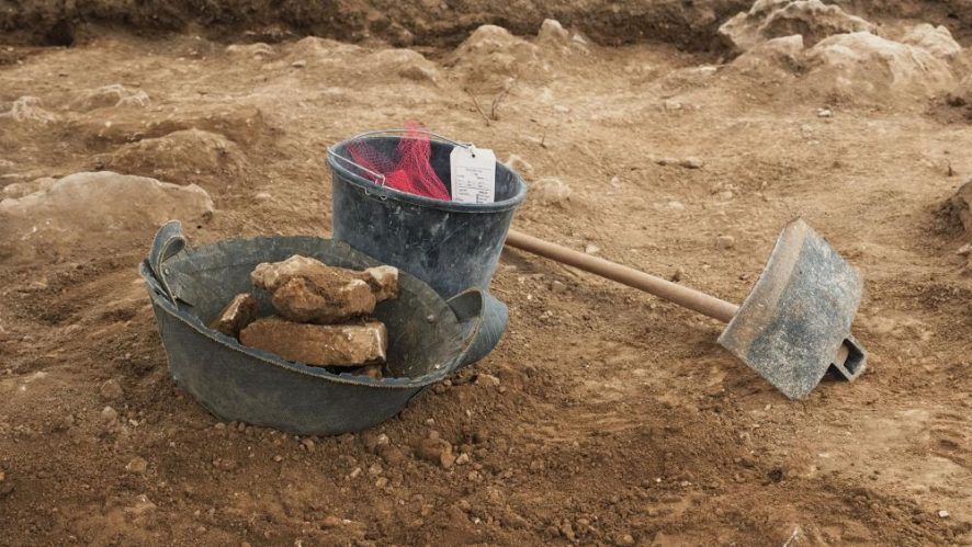 Unearthing ancient pottery, Photo, CBN News, Jonathan Goff