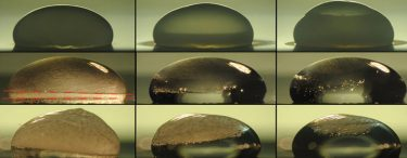 Images of a droplet on a surface show the process of freezing (top row), during which condensation temporarily forms on the outside of the droplet as it freezes. The next two rows show the droplet thawing out on a surface coated with the new layered material. In the middle row, the droplet is heated by the coating immediately upon freezing, and the dashed lines show where the freezing at top is just catching up with the thawing from below. The bottom row shows a slower thawing process. Under identical conditions, the droplet stays frozen without the new coating. (The Varanasi Research Group)