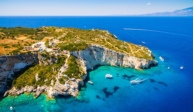 Aerial view of Agios Nikolaos blue caves in Zakynthos (Zante) island, in Greece.