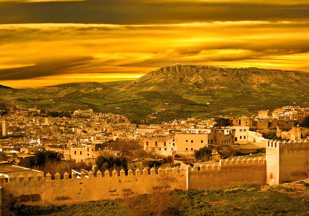 Landscape of Fez, Morocco showing the city wall  (Image: Much Morocco).