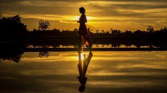 Walking along the Beach (Image by Sasin Tipchai)