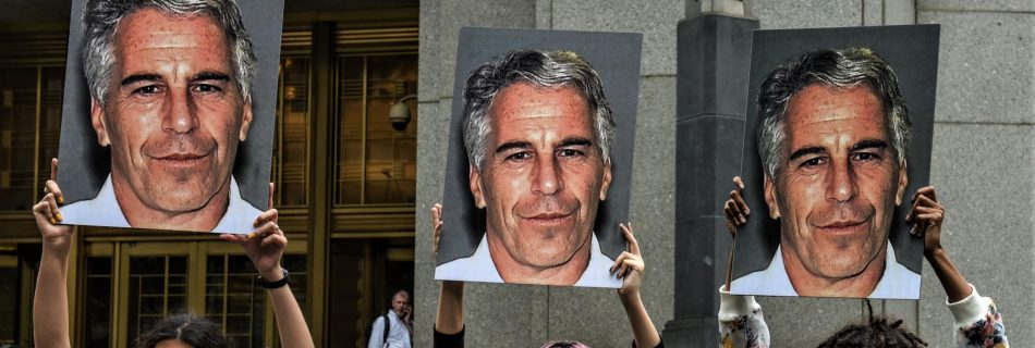 "A protest group called ""Hot Mess"" hold up signs of Jeffrey Epstein in front of the Federal courthouse on July 8, 2019 in New York City. (Image by Stephanie Keith/Getty Images)"