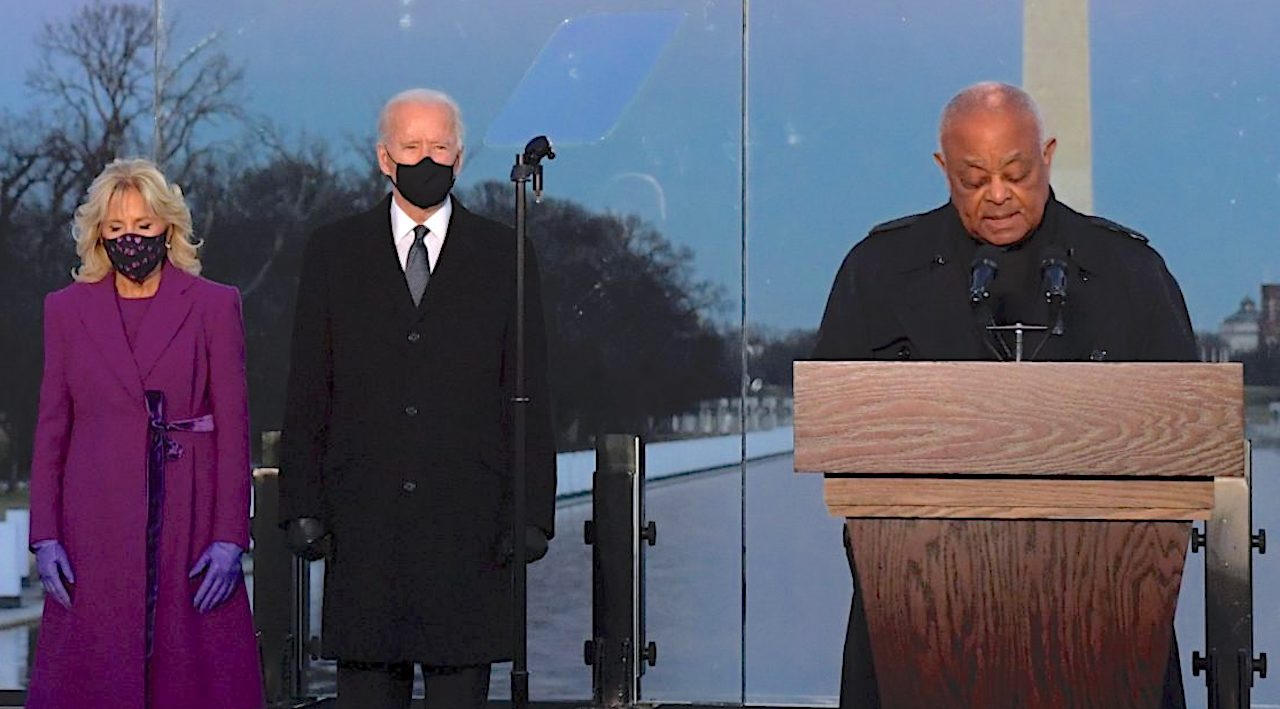 (L-R) US First Lady Jill Biden, US President Joe Biden and Cardinal Wilton Gregory, Archbishop of Washington at the Lincoln Memorial in Washington, DC. (Photo by Patrick T. FALLON / AFP) via Getty Images)
