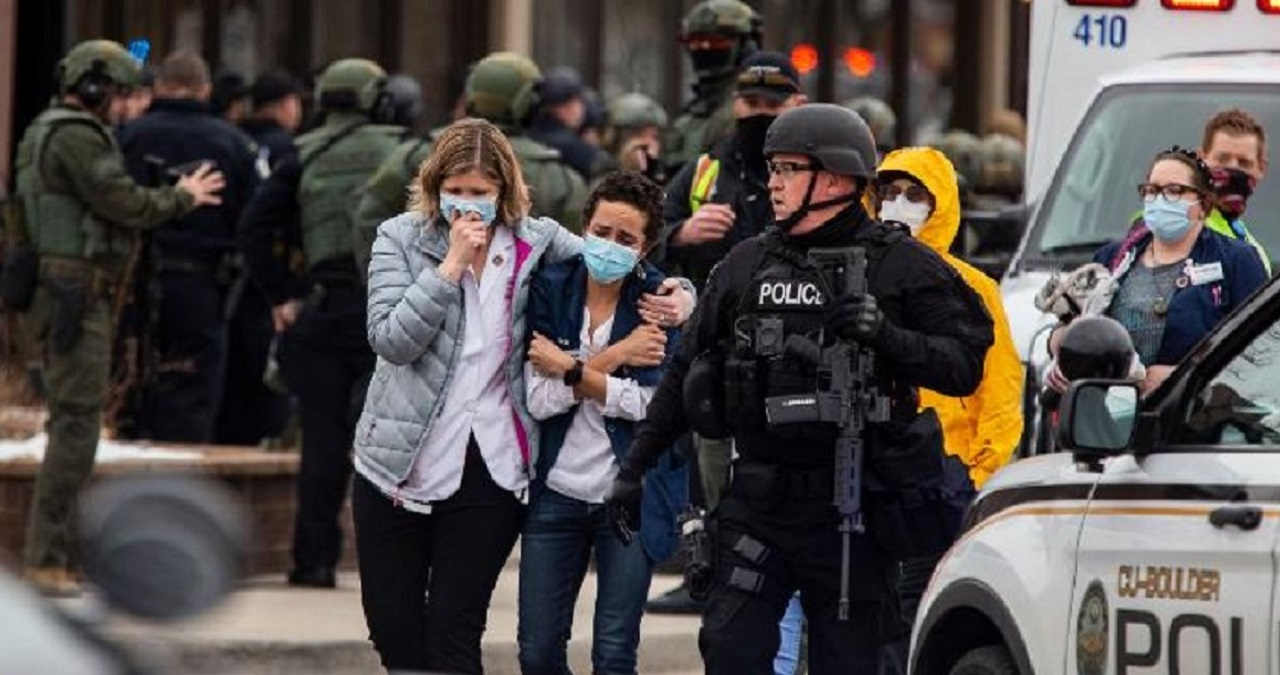 People walk out of a King Soopers grocery store in Boulder, Colorado, after a shooting there on Monday. (Getty Image)